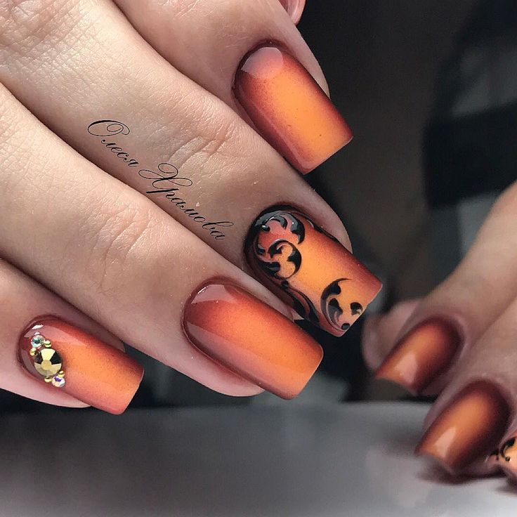Gorgeous red glow orange Halloween fall Autumn nails. Red brown Auburn outer fade bright lovely orange nail polish gel acrylic, gold nail adornment accent nail, transparent black leaf design accent nail advanced nail art ideas