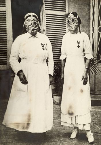American nurses in gas masks at a WWI front line U.S. Army hospital in France. Photo by Paul Thompson [National Geographic].