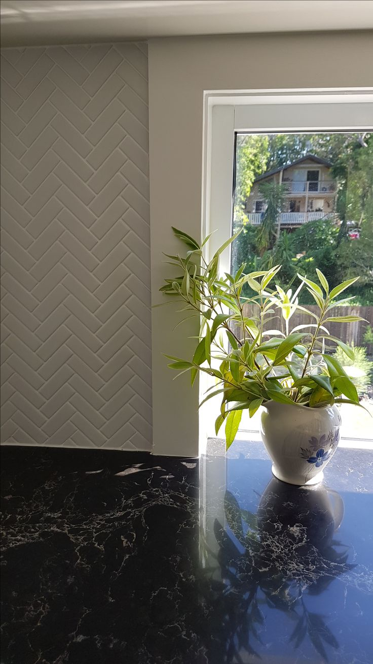 simple satin white herringbone mosaic ...all that was needed to finish the job