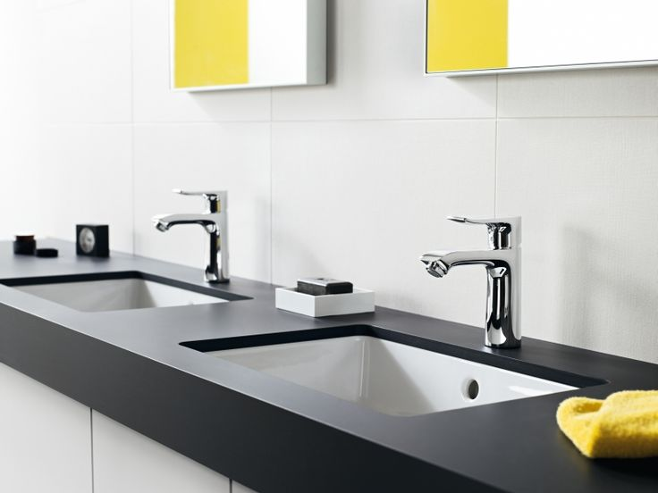 Water en energie besparen in de badkamer doe je met besparende kranen • Foto: www.hansgrohe.be (dubbele lavabo)