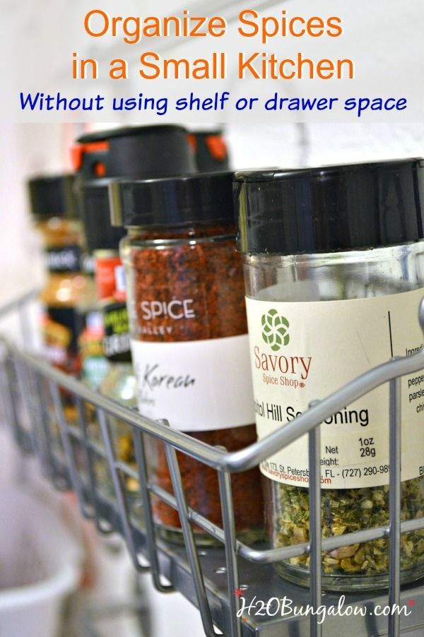 Free up lots of shelf space!  Take advantage of an unsed wall and add storage for organized spices in a small kitchen without using shelf or drawer space.   http://H2OBungalow.com #smallhome #organize