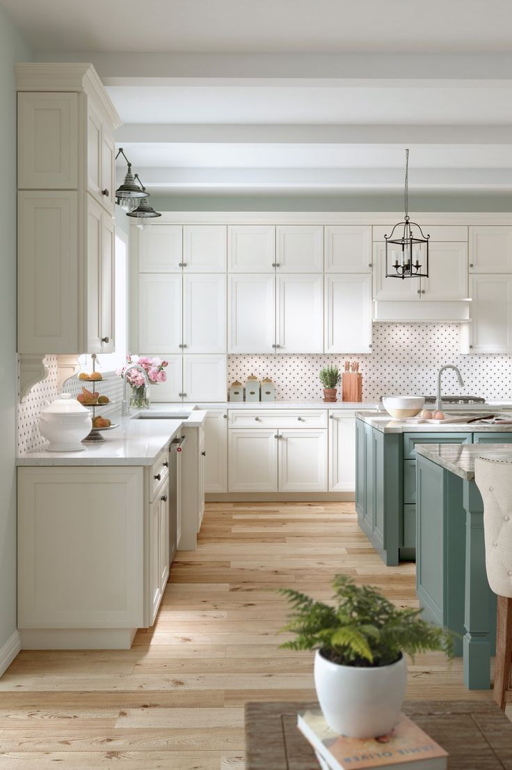 Traditional kitchen with classic matt cream doors and double island with teal matt doors. Oak wood flooring and granite worktops with integrated sinks. Also featuring cage lighting. CGI 2017, design by shadowlightgroup.com and all CG production by www.pikcells.com