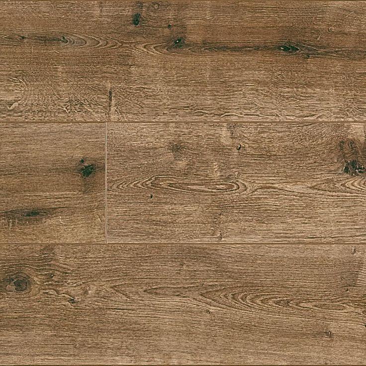 SE6959 Kent Oak - Een donkere bruintint met subtiele lichte aspecten en spiegels. Donkere kleine noesten en nerven geven dit decor de rustieke look van echt bos hout. Een geschikte vloer voor een boerderijwoning of een woning met (antiek) donkerhouten meubilair.