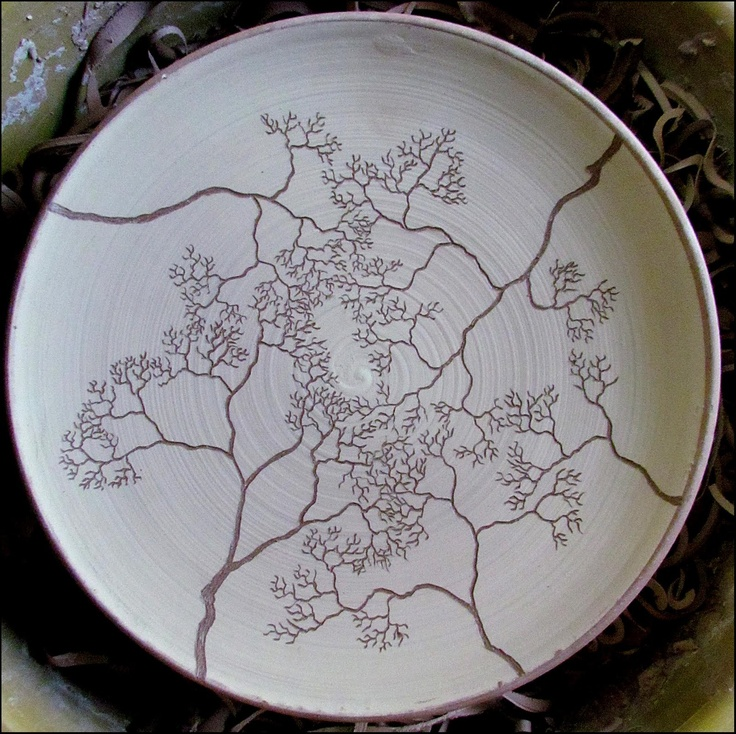 Nice plate, carved through white slip on red clay.