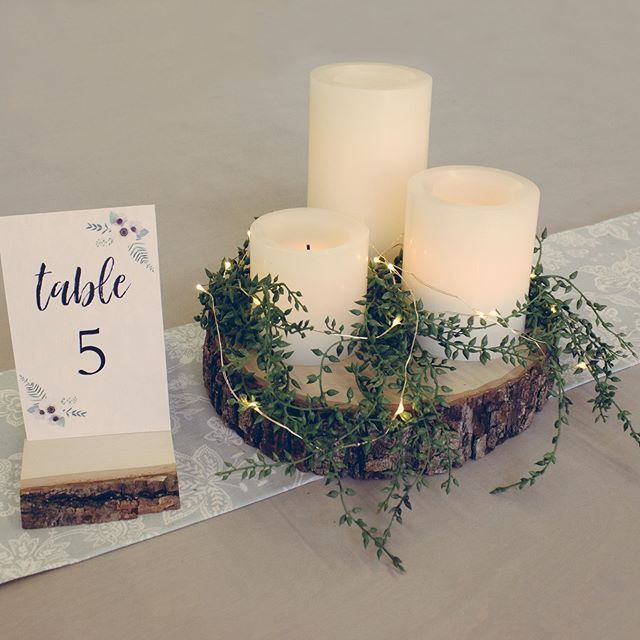 Wow your wedding guests with this elegant, rustic, and classic centerpiece (you will also be wowed by how easy this is to create)! We used our Thick Basswood Country Round for the candle display with some greenery and firefly lights.