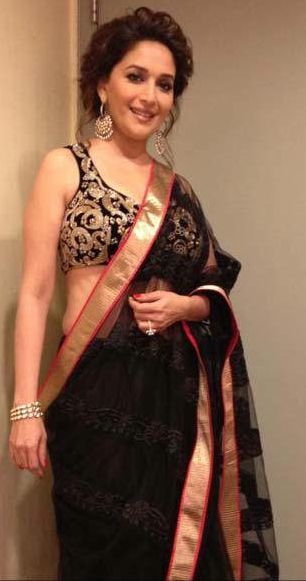 Madhuri Dixit Nene Looking absolutely stunning in a plain black sari with gold boarder.