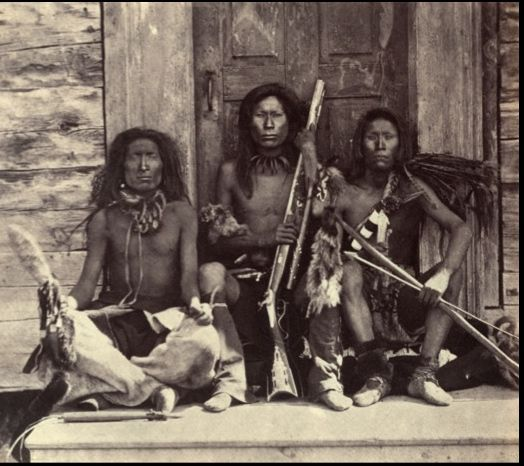 Many Northwest tribes signed treaties with the federal government in the mid-1950s; by coincidence, the new art of photography arrived here at the same time. One of the earliest photos of the region: Chief Spokan Garry's inner circle warriors at Hudson's Bay Company outpost, Kettle Falls, Washington. British Northwest Boundary Survey Commission photo. [Library of Congress]