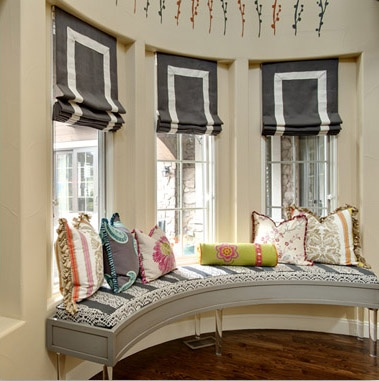"flat roman shades, tape trim ... use the same fabric from front room drapes to make the ""tape trim"" and use that pattern on top of solid fabric ... way to integrate pattern between two adjoining rooms without over-using the pattern"