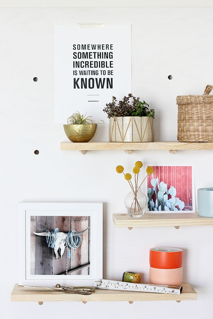 Make this DIY modern pegboard for your home office. Use basic power tools to create a shelving system to display your favorite art, trinkets and tools. | www.homeology.co.za
