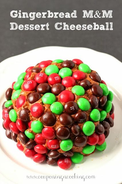 A gingerbread twist on a traditional dessert cheeseball, topped with Gingerbread M&M's it's the pefect holiday dessert! www.CouponingNCookin...