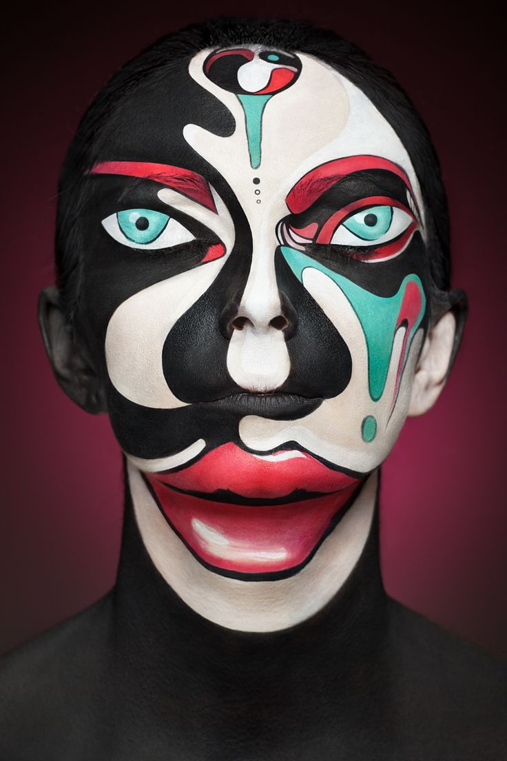 Faces of Models Transformed Into 2D Images with Face Paint face painting