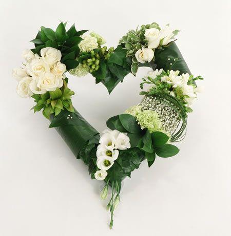 ENTRY DOOR: hart shaped wreath of ti-leaf, ivory spray rose, hypericum berries, babies breath, bear grass, lemon leaf, ..... www.floralinterludes.blogspot.com