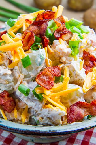 LOADED BAKED POTATO SALAD: ~ Recipe Courtesy of Kevin Lynch ~ All of the flavours of fully loaded baked potatoes including bacon, cheddar, sour cream and green onions in a potato salad that is perfect for summer entertaining