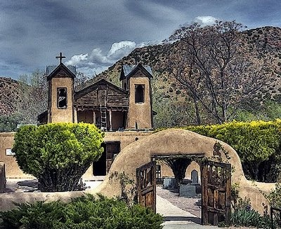 """Only 30 miles from Santa Fe, New Mexico is El Santuario de Chimayo where 300,000 visitors each year come to scoop sand from a hole in the floor of the """"Room of Miracles."""" Its walls are lined with letters and photographs from hundreds of thankful pilgrims who say they were healed here."""