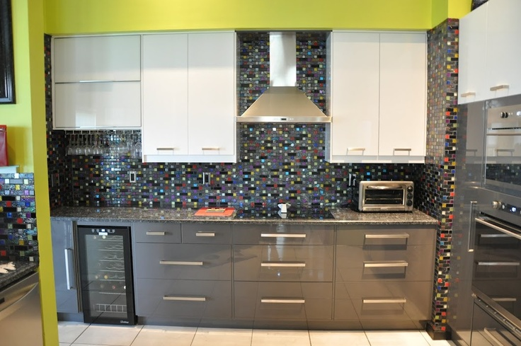 a funky kitchen in dark grey white and lime green with