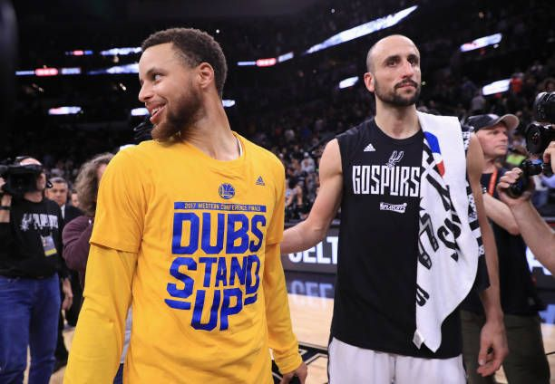 Stephen Curry of the Golden State Warriors stands with Manu Ginobili of the San Antonio Spurs after the Golden State Warriors defeated the San...