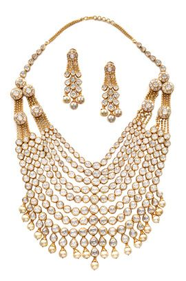 Indian Wedding Jewelry - Bridal Polki Set | WedMeGood Heavy Polki Layered Bridal Set with Pearl Drops, and Polki Drop Earrings with Pearls. #wedmegood #bridal #jewelry #polki #pearl