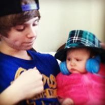 Me and my baby sister, it looks like I was going to punch her but I wasn't don't worry :p
