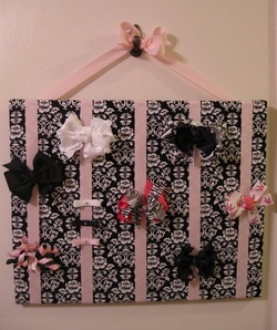 Making a bow holder to hang over changing table for kendall's new room in new house.