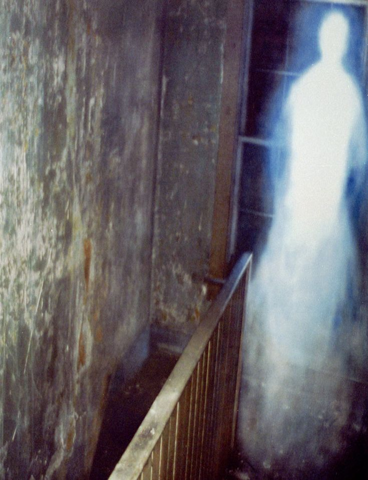 Missouri Paranormal Research picture: This Photo was taken at an investigation of an old abandoned by a man named Tom who reports he was standing in a doorway at the top of the stairs when he looked down and seen the entity moving up the stairs towards him, he waited and snapped this shot just as it got to the top of the staircase, which by then it was beginning to fade and disappear.