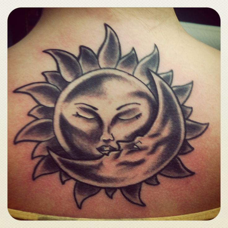 Affectionate kiss of Sun and moon tattoo Affectionate kiss of sun and moon, medium size tattoo located at the back for girls. - Download