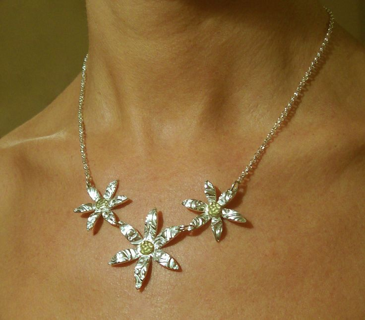 Designed and made by Nuit Nuit.Pure silver (.999) 3 flowers with 24crt gold coated centre buttons on a sterling silver belcher chain