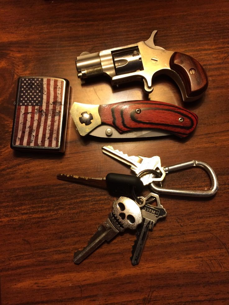 "daily-carry: ""Pretty simple EDC. My keys, small pocket knife, .22 short revolver and my lucky patriotic zippo. """