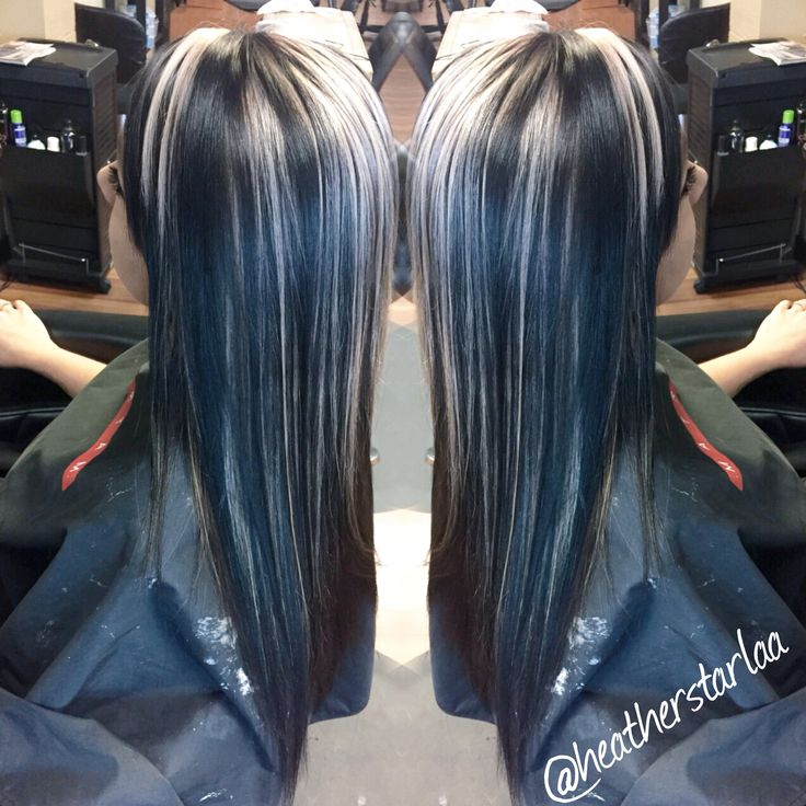 All over black hair with chunky platinum blonde highlights.