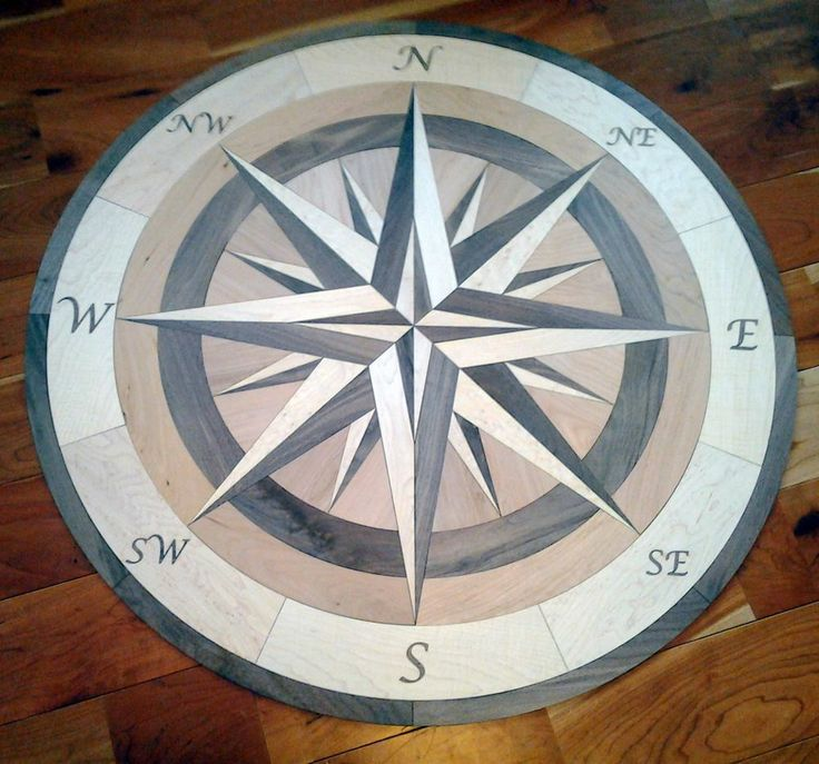 Medallion floor compass in entry way pinterest for Wood floor medallions inlay designs