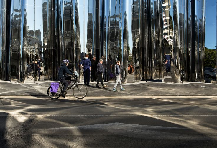 The shiny exterior engages pedestrians and reflects light patterns onto the street. Photograph by Simon Devitt.