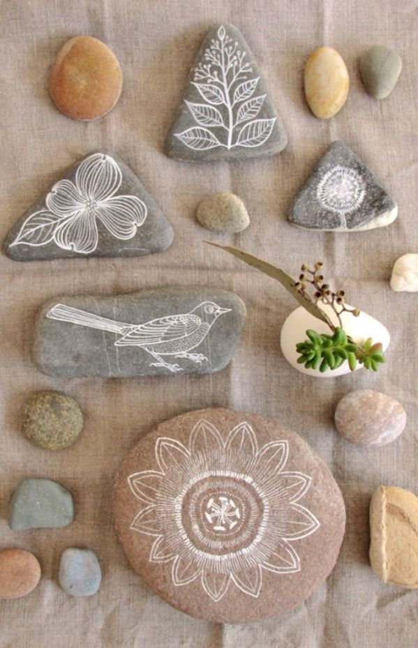 Hand painted rocks using white arcylic and a fine round brush