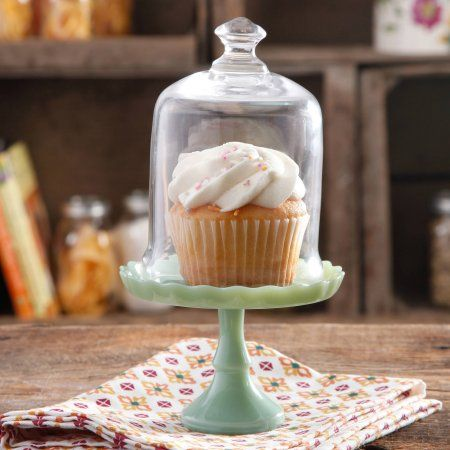 Display and serve scrumptious petite desserts and cakes in style with this 5.25-Inch Mini Cupcake Stand. The beautiful jadeite color and glass cover dome with its gracefully sculpted handle add elegance to any dessert presentation. To clean, please hand wash only!