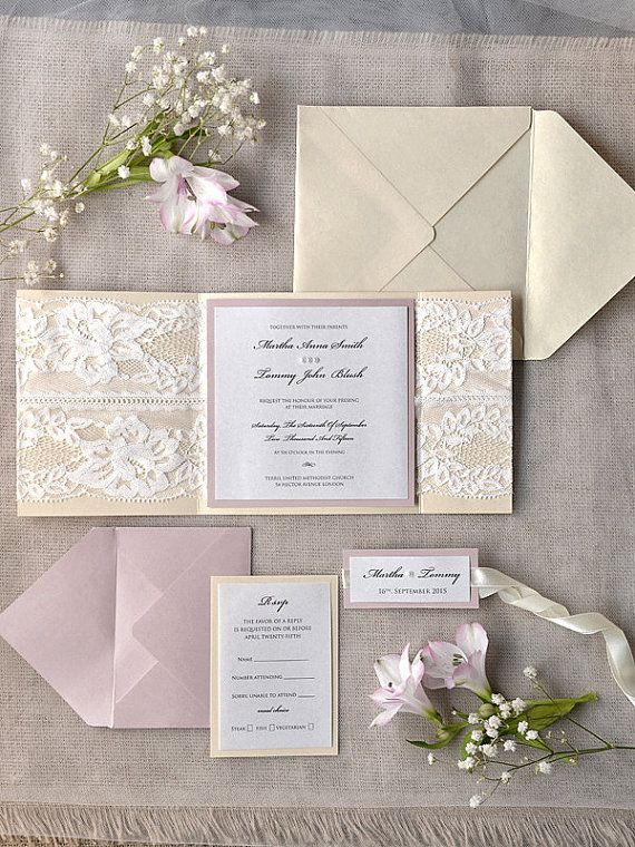 Big fan of lace integrated into pocket fold invitations. Only thing I'd switch here is switch out the pink and replace it with dark purple.