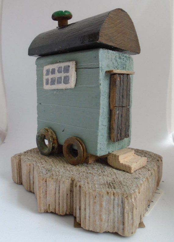 Shepherd's hut made from driftwood and recycled metal