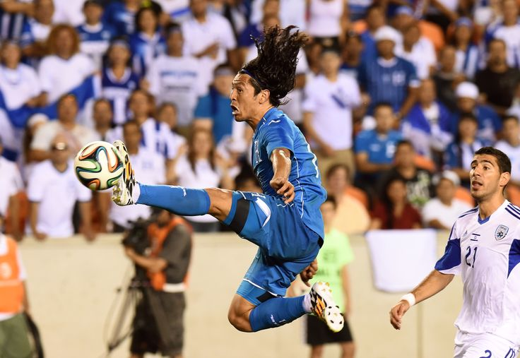 Honduras' midfielder Roger Espinoza kicks the ball as Israel's Eytan Tibi (R) looks on during their World Cup preparation match at the BBVA Compass Stadium in Houston, Texas