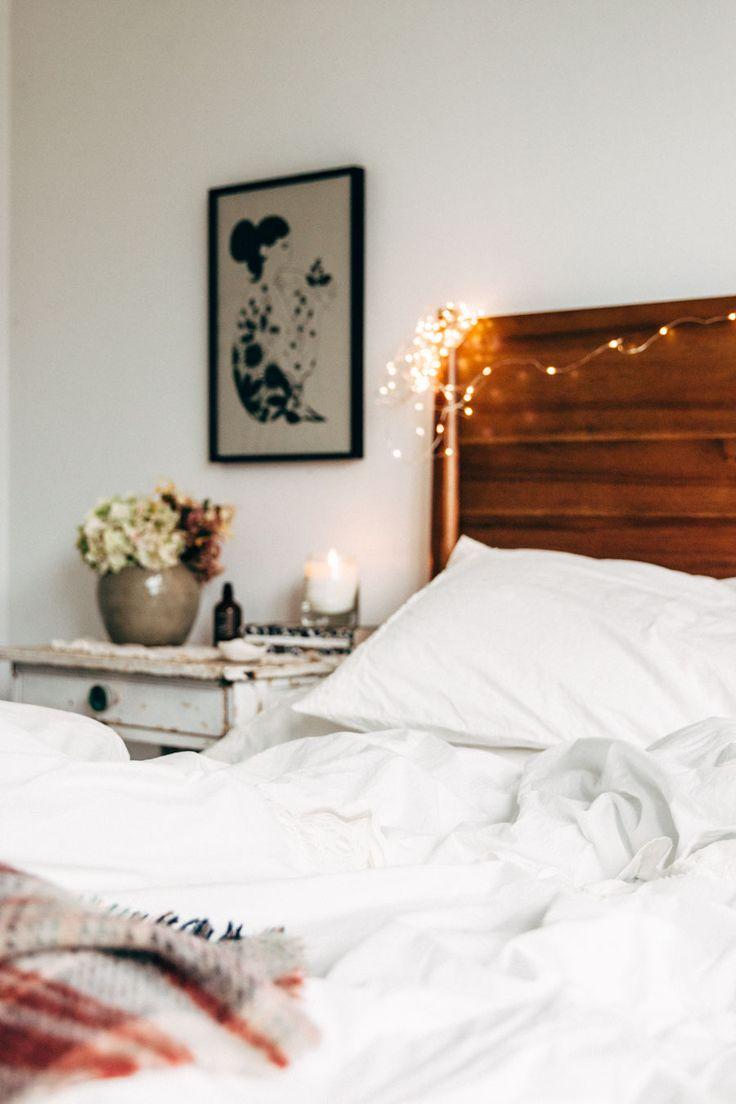 wooden headboard and twinkle lights