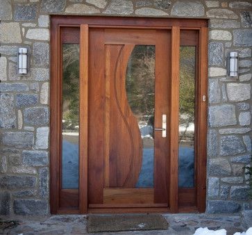 A fun geometric curve with beautiful, rich wood tone, and simple glass panes. I would add a bow or wreath of bright, luscious greens, blues and grays to set off this charming door.