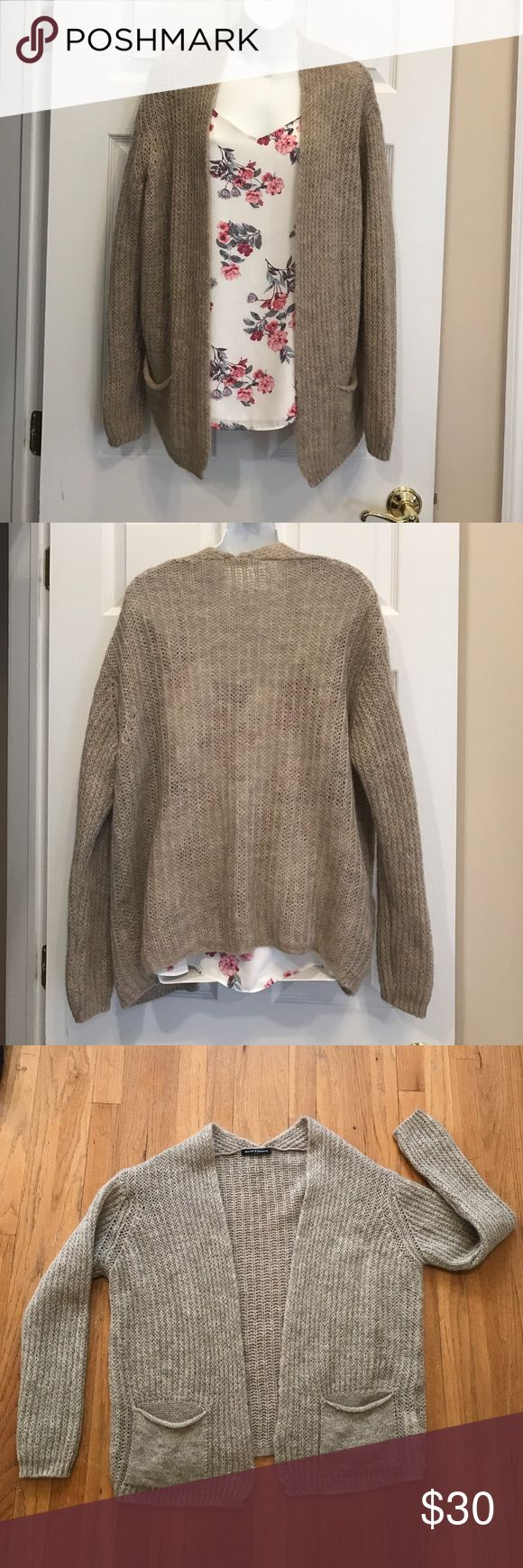 Brandy Melville Cardigan One size. Cream/tan color. Excellent condition.  Pockets in front. 70% Wool, 30% acrylic. Brandy Melville Sweaters Cardigans