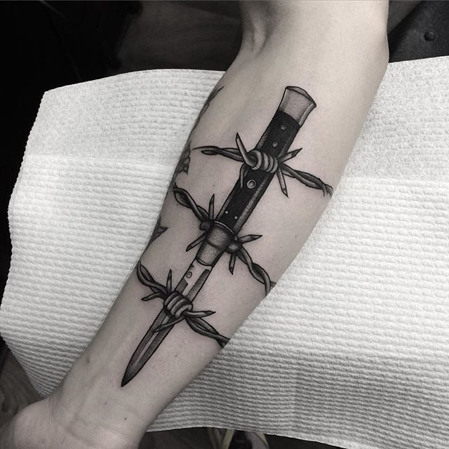 Barbed Wire Dagger Tattoo by Levi Tattoos #barbedwire #traditional #dagger #levitattoos