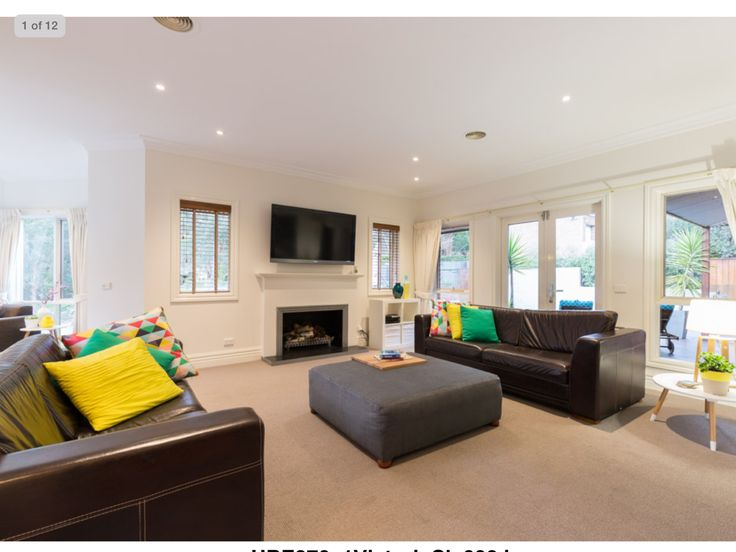 Bright colours on neutral decor lightens the mood
