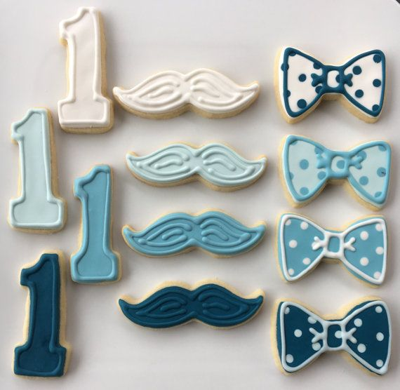 **** PLEASE SEE THE SHOP ANNOUNCEMENT FOR AVAILABILITY & IMPORTANT SHIPPING INFO ****  Simply delicious custom decorated sugar cookies. This listing includes 1 DOZEN made to order Assorted Little Man sugar cookies. Assortment includes your choice of mustaches, bow ties, #1s, onesies, and round personalized cookies. You may choose up to 4 colors to coordinate with your event. Upon placing your order, please indicate the shapes and colors in the notes from buyer or convo me with the info. A...