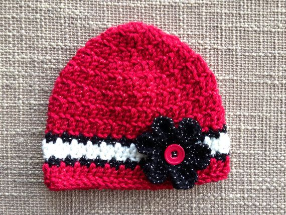 This Wisconsin Badgers beanie is perfect for kids and adults alike. Whether it's for a special occasion or a photography prop, you will love the quality of this handmade piece. My hats are great for gift giving, who doesn't love a handmade gift?? Show your Wisconsin pride with this beanie today!    Red sparkle yarn, black sparkle yarn and white yarn make this hat extra girly for your game day attire! :: M A D E T O O R D E R ::  When you purchase this hat please include the size (see size…