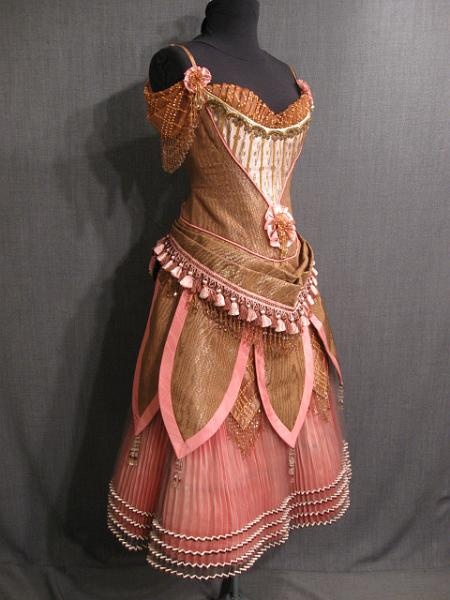 1880's Bronze Moire Saloon Girl Dress.  A slight change to the skirt, colors and removing the flowers would make this perfect garb!
