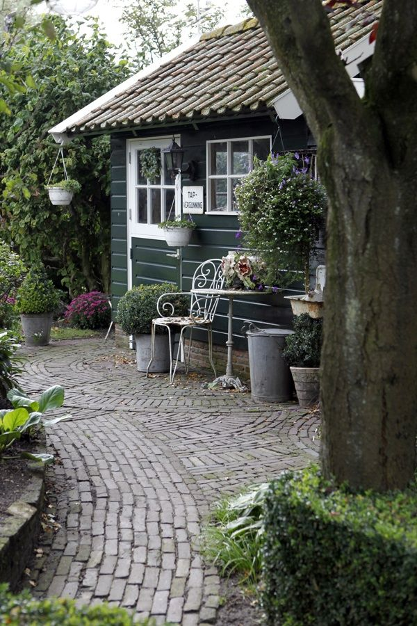 At the end of the path is a tiny cottage with big style