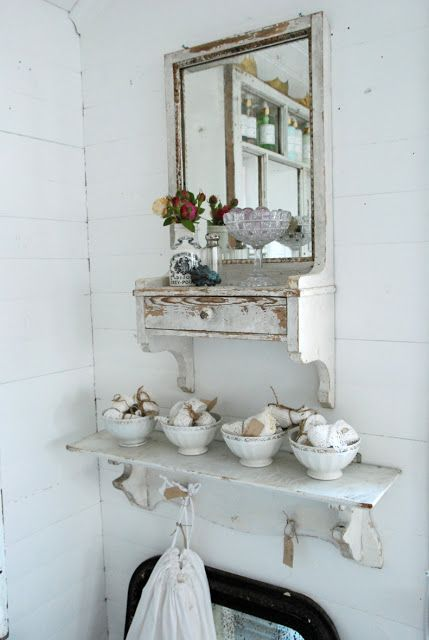 ..Entry near kitchen. Cup for keys, mirror for grooming self, knob and pegs for hanging aprons etc.
