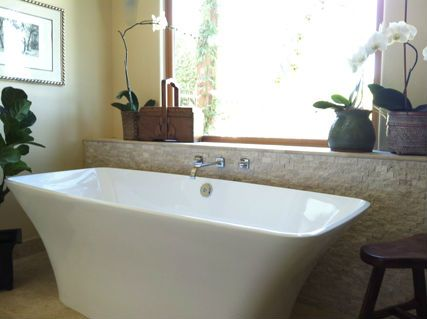 Free Standing Bath Tub Backed Up By Split Face Travertine Mosaic Tile With  A Travertine Pencil Liner Trim And Honed And Filled Floors.