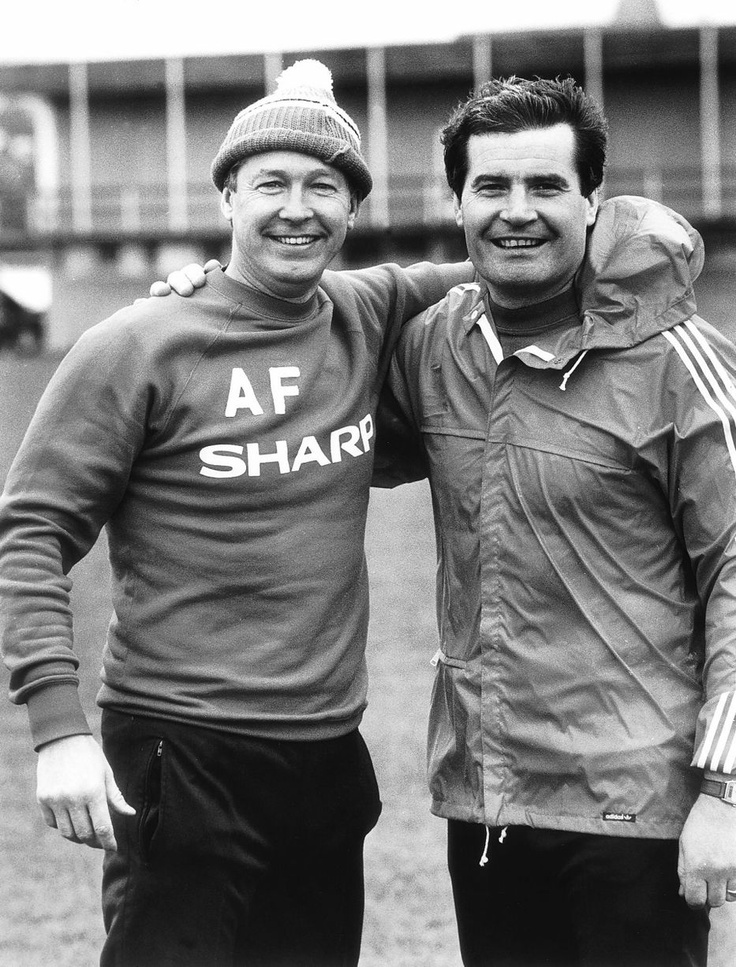 Manchester United manager Alex Ferguson and his assistant Archie Knox pose for a picture in December 1986
