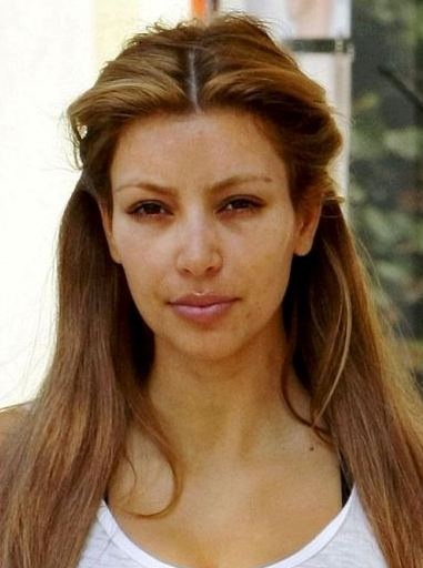 for all the glammed up shots of kim Kardashian, here's no makeup, not photoshopped photo so you can see she's just like the rest of us mere mortals and does not look like you see her look without a whole lot of makeup magic.  so don't feel bad about yourself...