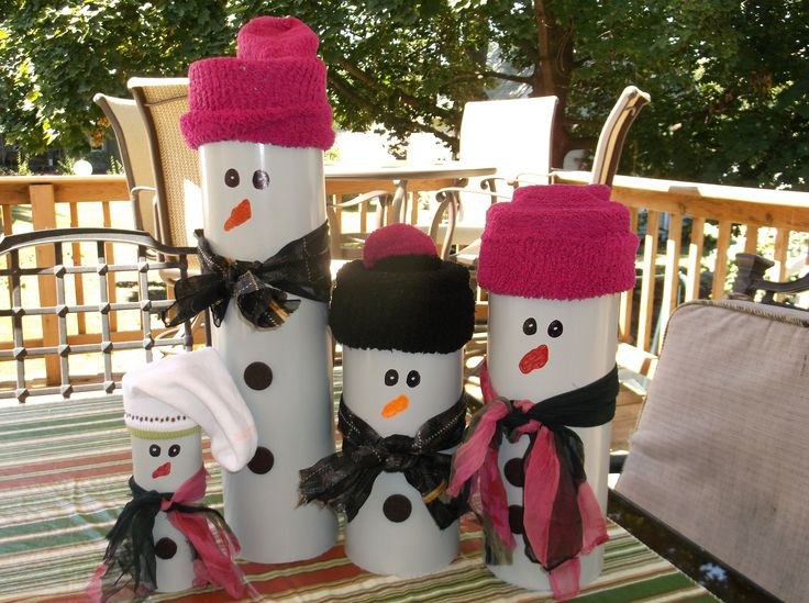 Those were so much fun to make,take a 6 inch round PVC Pipe, spray paint it white, draw on face with paint marker, and for the stocking cap i used small socks, but you also can use a stocking  cap, tie a scarf around the neck, we used chair pads for buttons. Now all we need is snow.