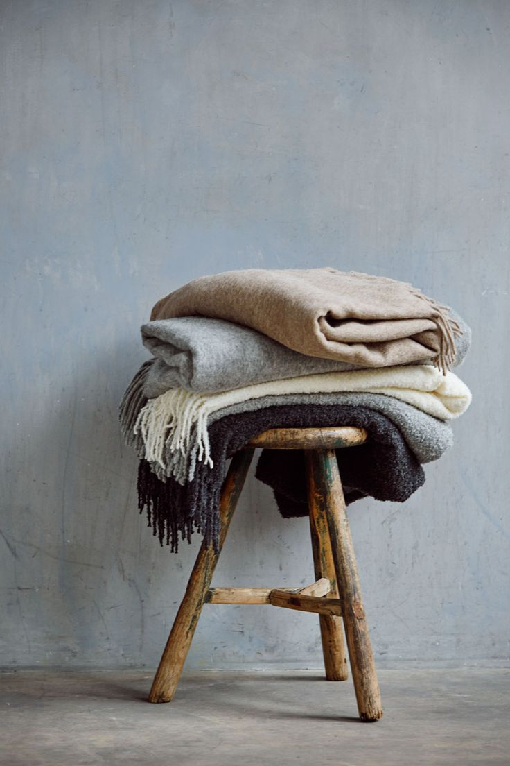hush-blog | New for AW15 | amazing stack on neutral coloured blankets on a wooden stool